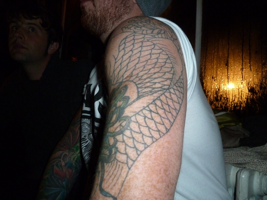 Lee arm tattoo