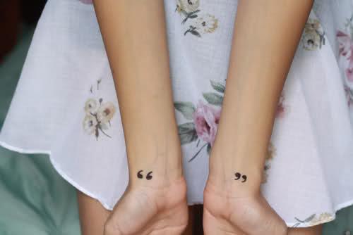 Speech marks tattoo