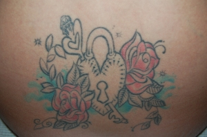 heart, locket and flower tattoo