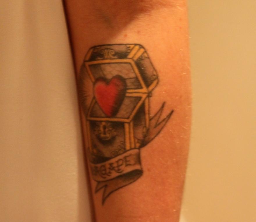 Treasure chest and agape tattoo