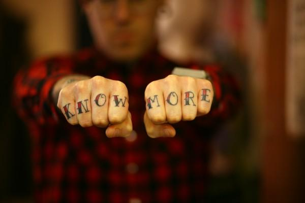 Know More hand tattoo