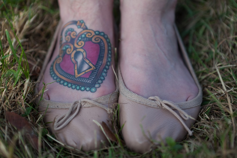 Padlock tattoo on foot