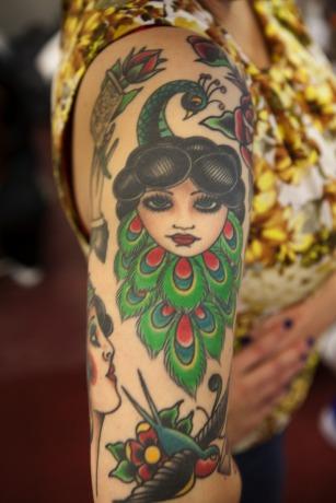Peacock lady tattoo