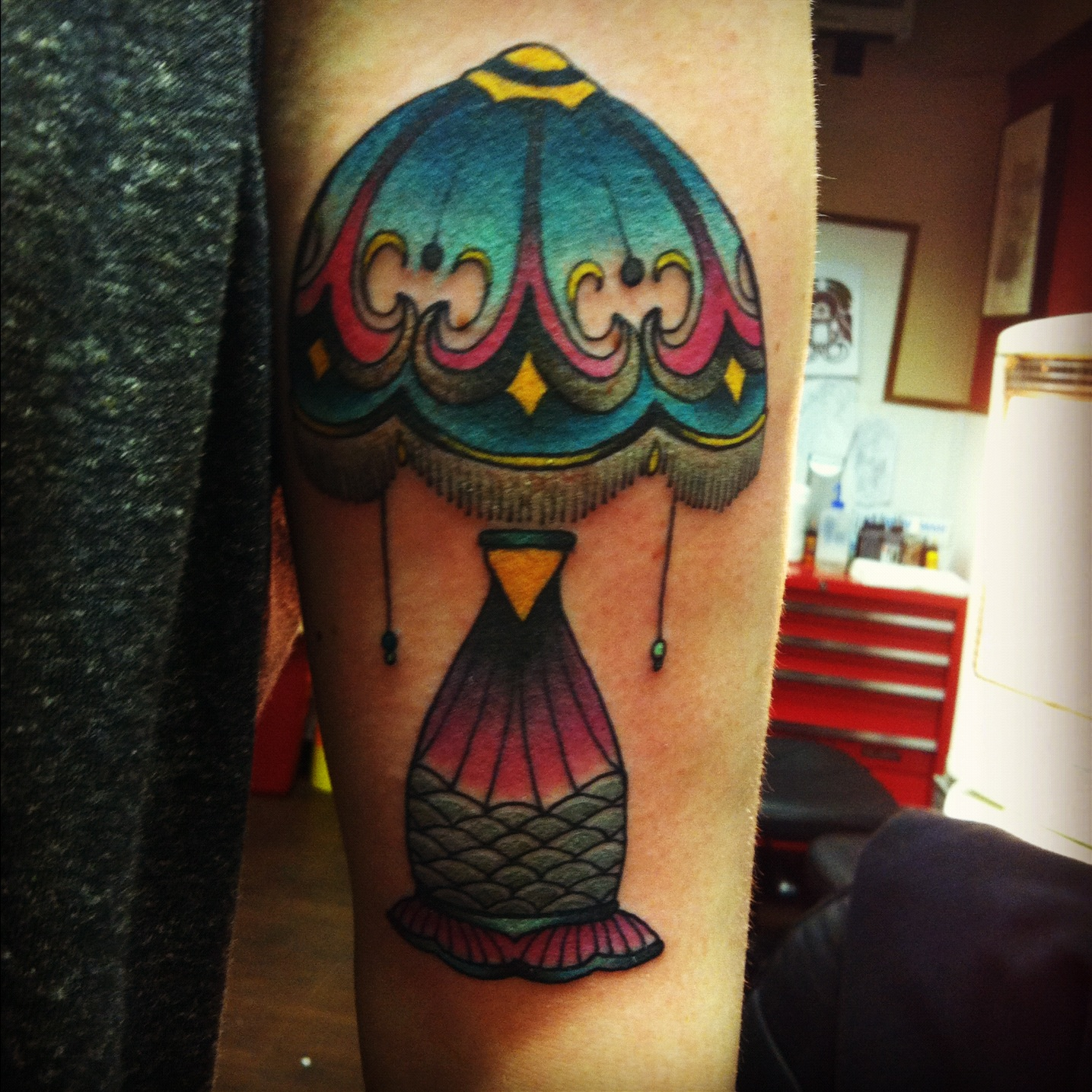 Claudia De Sabe lamp tattoo